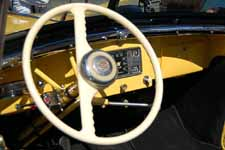 Beautifully restored 1949 Willys Overland Jeepster dash and steering wheel with original horn button