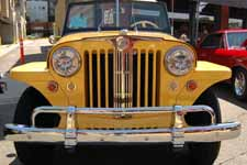 Perfectly restored front grille and stainless steel trim piece on a 1949 Willys Overland Jeepster