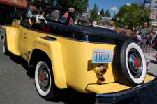 Photo of 1949 Willys Overland Jeepster shows rear end, rear fenders and convertible top boot
