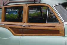 Detailed photo shows original white ash and mahogany wood on the side of a 1951 Buick Estate Wagon woodie