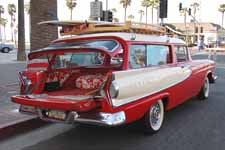 Photo shows very cool 1958 Edsel Roundup station wagon with surfboards on the wood roof rack