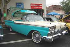 Photo of Vintage 1959 Ford Galaxie Flip-Top Convertible Showing Top Folding into Trunk
