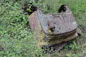 Rusty cowl section from wrecked Ford pickup truck, stored in classic car junkyard