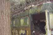 Rotting but oroginal passenger bus found in vintage car junkyard