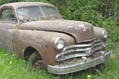 Very clean Dodge project coupe in vintage car junk yard