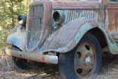 Early Ford flatbed truck in vintage car storage