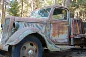 1930's Ford truck at vintage car junkyard needs full restoration