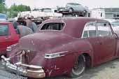 Rare and luxurious Lincoln 4 dor sedan stored at vintage car salvage yard