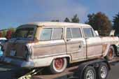 Restorable 1950's Mercury woodie wagon in vintage car storage lot