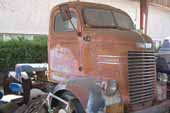 Dodge COE truck in restorable condition at vintage car storage yard