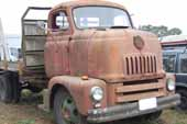 Awesome old cab-over truck stored in vintage truck salvage yard