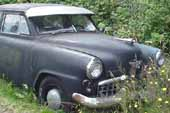 Rare Studebaker sedan project car in vintage car wrecking yard