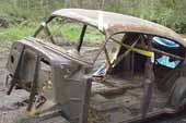 4-door vintage sedan body stripped bare and ready for restoration at classic car wreckingyard