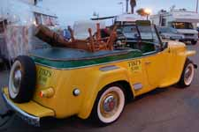 Classic Willys Jeepster has been restored with new Sportsman's Green and Fiesta Yellow paint job