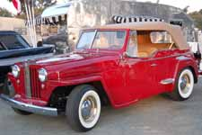 Restored Willys Jeepster Sports Phaeton looks great in factory correct Luzon Red paint job
