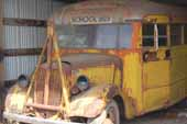 Very cool original 1930's Ford school bus for restoring, parked at vintage car storage lot